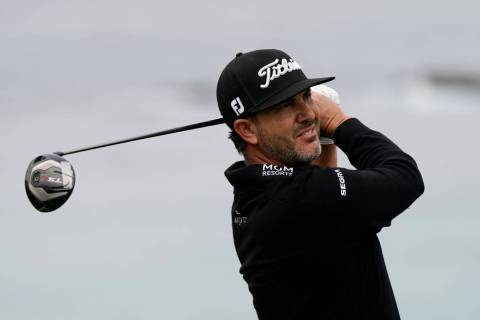 Scott Piercy watches his tee shot on the 11th hole during the first round of the U.S. Open Cham ...