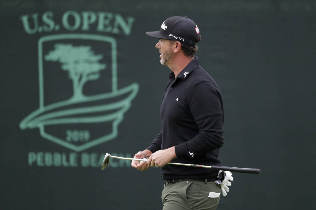Scott Piercy walks off the third green during the first round of the U.S. Open Championship gol ...