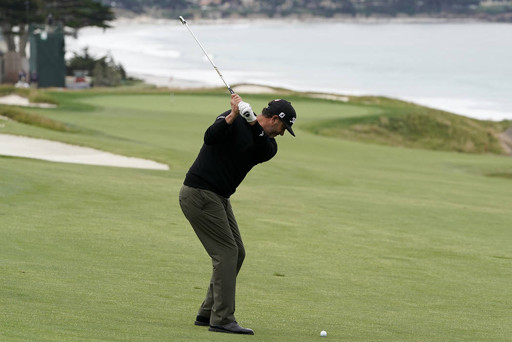 Scott Piercy hits from the fairway on the 10th hole during the first round of the U.S. Open Cha ...