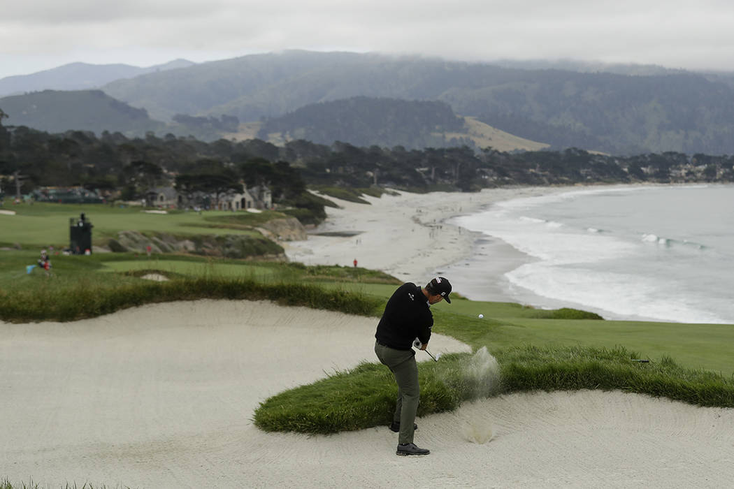 Scott Piercy hits out of the bunker on the ninth hole during the first round of the U.S. Open C ...