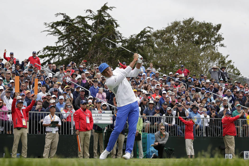 Rickie Fowler watches his tee shot on the 17th hole during the first round of the U.S. Open Cha ...