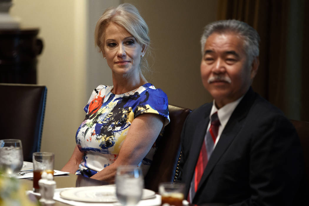 White House counselor Kellyanne Conway, left, and Hawaii Gov. David Ige listen as President Don ...