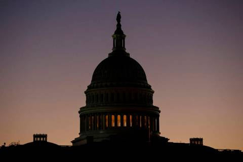 The U.S. Capitol Building Dome is seen before the sun rises in Washington, Tuesday, Dec. 18, 20 ...
