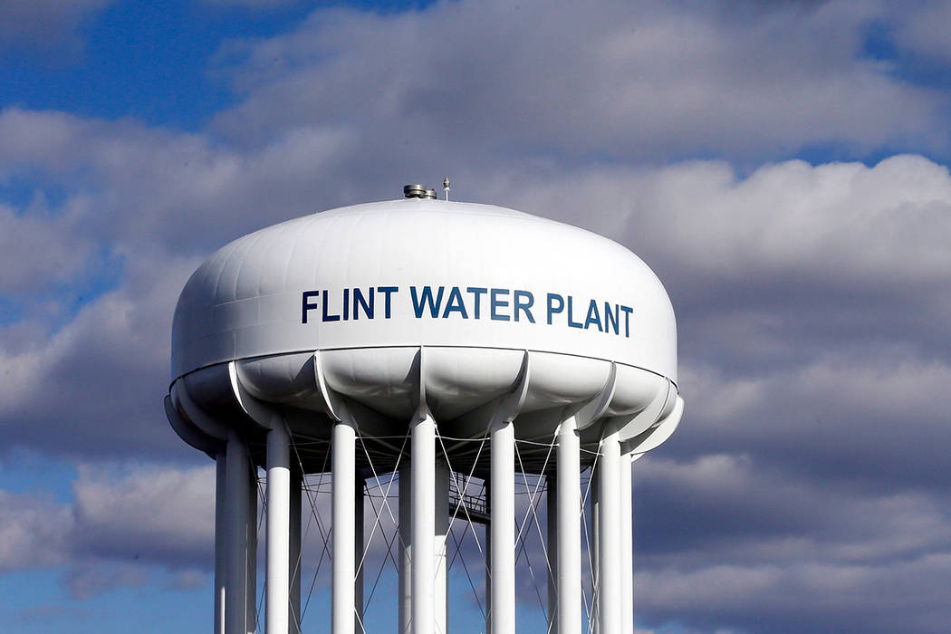 FILE - In this March 21, 2016 file photo, the Flint Water Plant water tower is seen in Flint, M ...