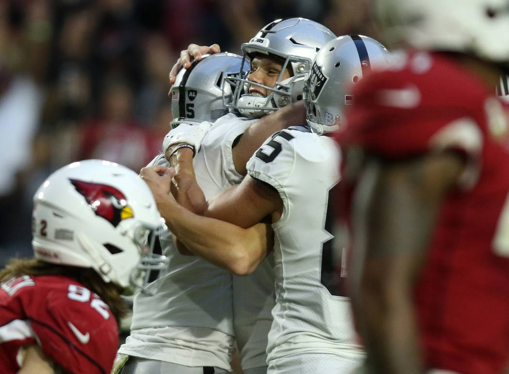 Oakland Raiders kicker Daniel Carlson (8) celebrates his game-winning field goal with punter Jo ...