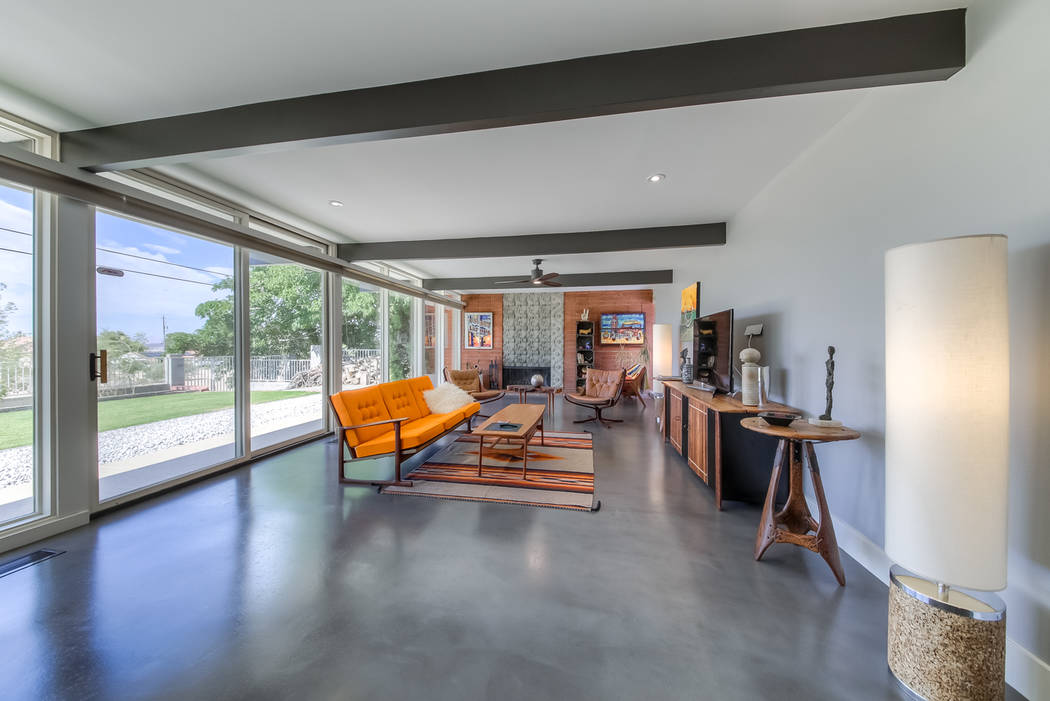 This home features window walls to capture natural light. (Realty One Group)