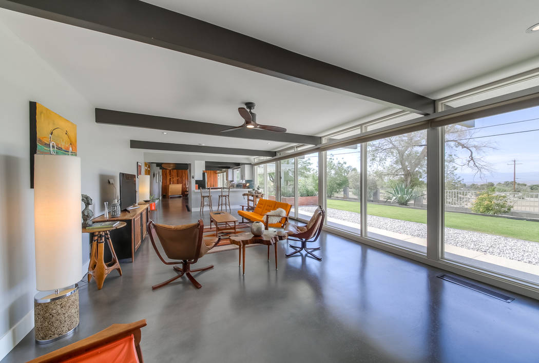The carpeted areas was replaced with stained polished concrete flooring in the great room. (Rea ...
