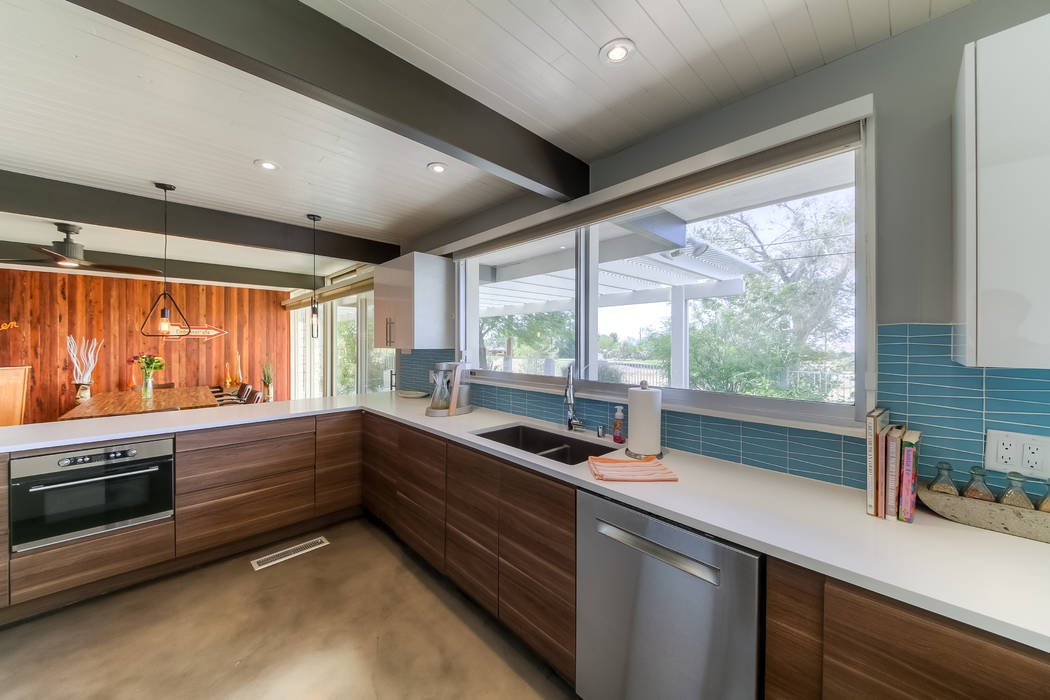 The kitchen opens to the bar and dining area. (Realty One Group)