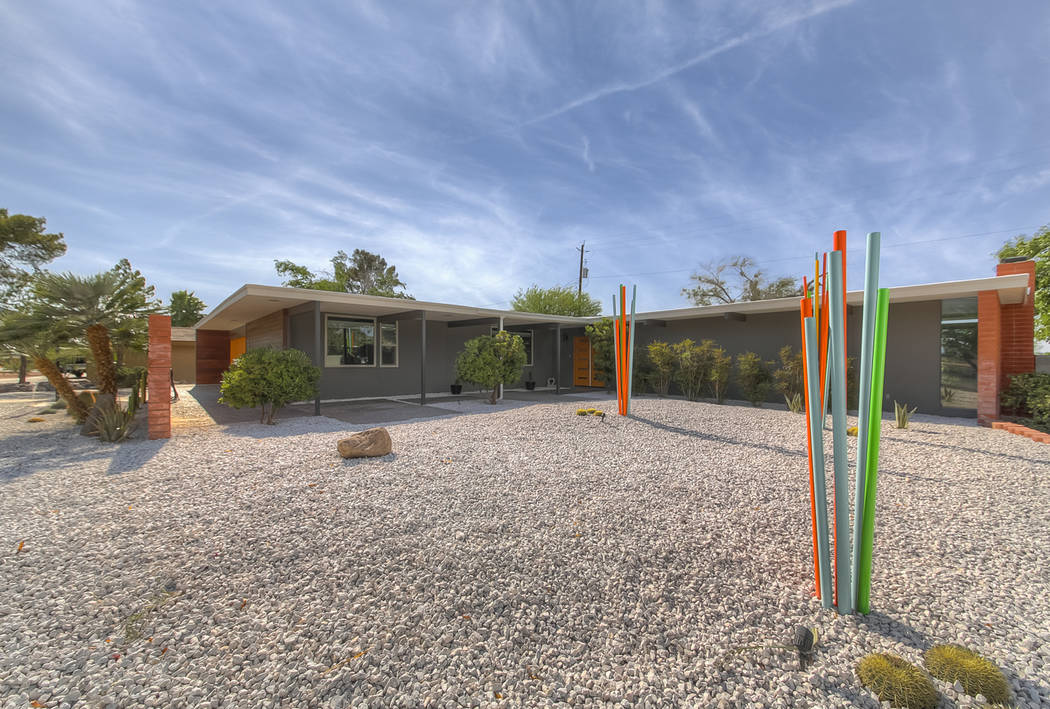 The front yard art is made of steel spikes, ranging in size of 4 to 12 feet. It was done by loc ...