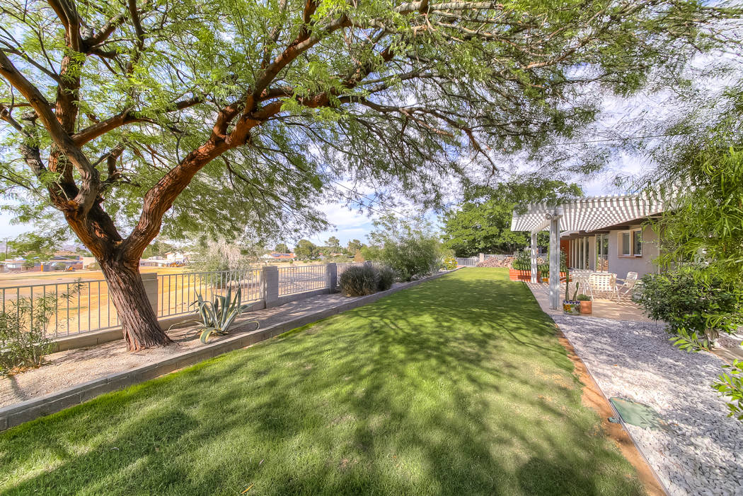 The Henderson midcentury home is in an established area and has lush landscaping. (Realty One G ...