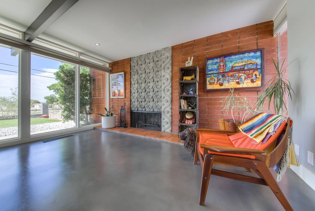 The original fireplace was restored with its original concrete tile. (Realty One Group)