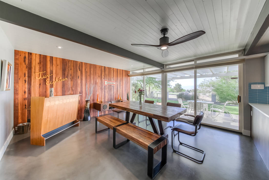 One room features a dining area and a bar. The home's original address was repurposed as artwor ...