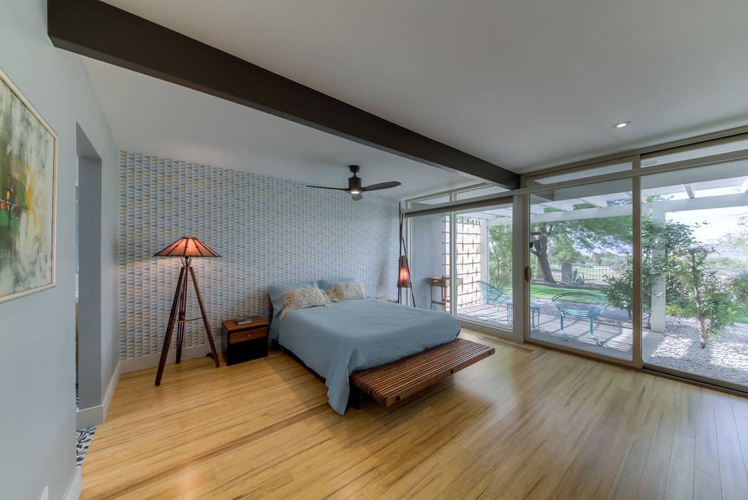 The master bedroom opens to a patio. (Realty One Group)