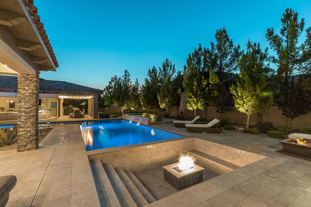 The backyard has a fire pit. (Ivan Sher Group)