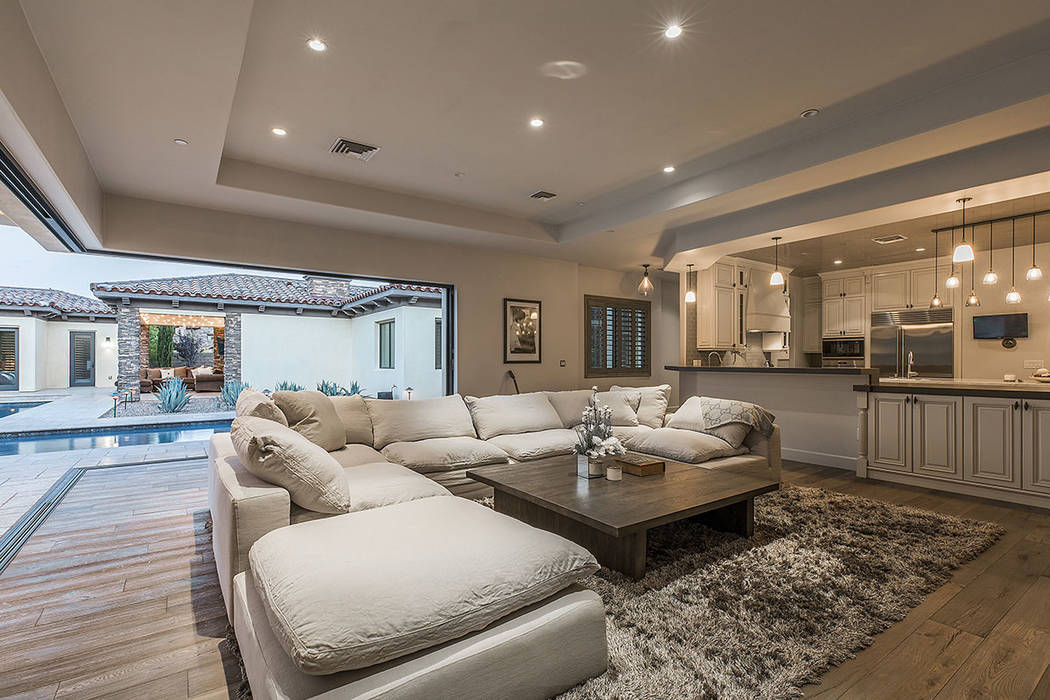 The great room opens to the pool. (Ivan Sher Group)