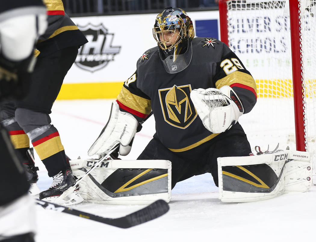 Golden Knights goaltender Marc-Andre Fleury (29) defends the net during the second period of an ...