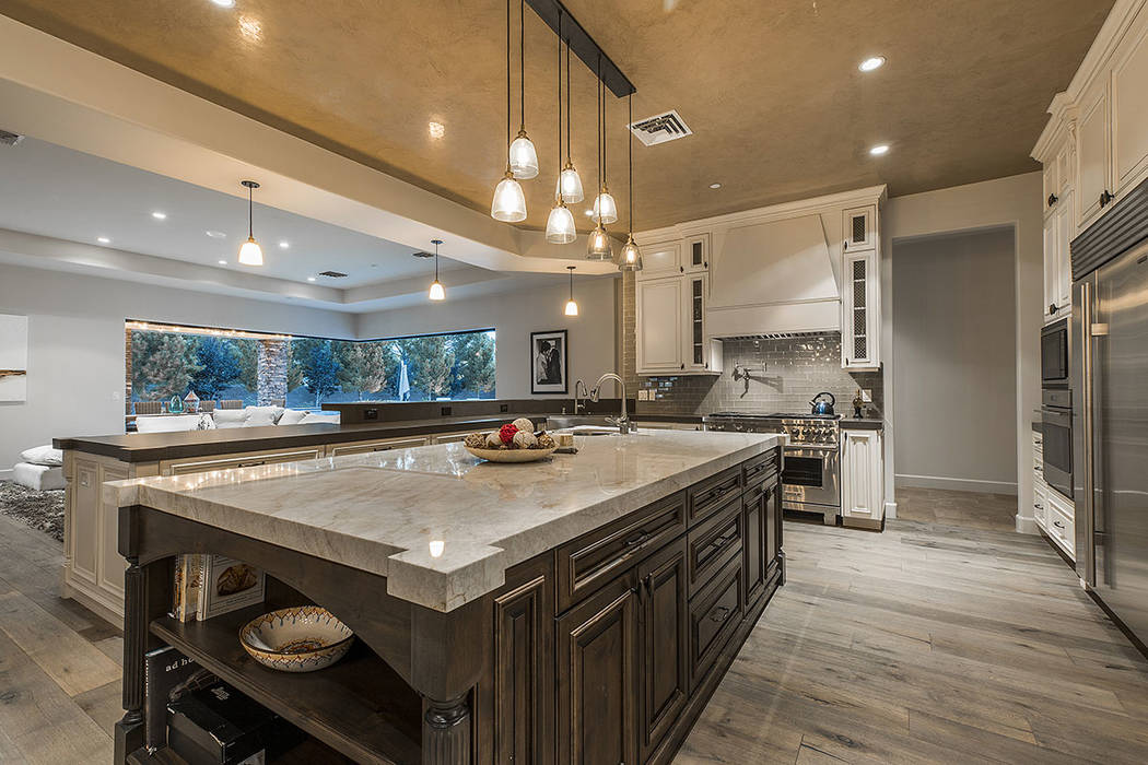 The kitchen has a large center island. (Ivan Sher Group)