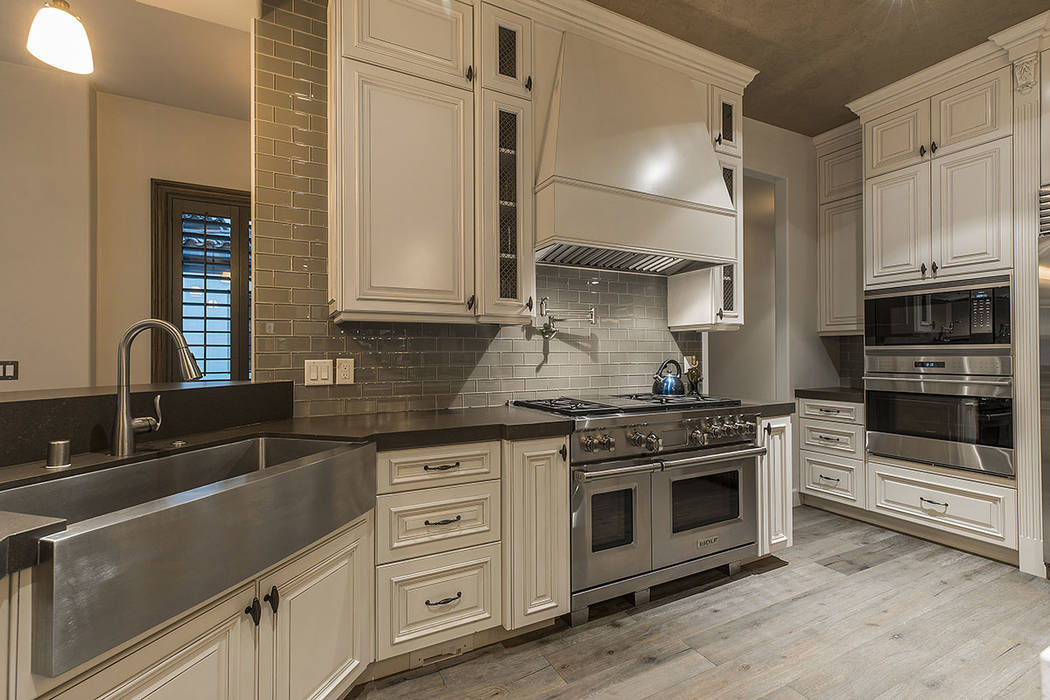 The kitchen features stainless steel appliances and a large farmers sink. (Ivan Sher Group)