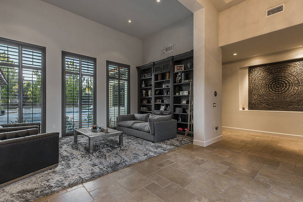 The living room faces the pool. (Ivan Sher Group)