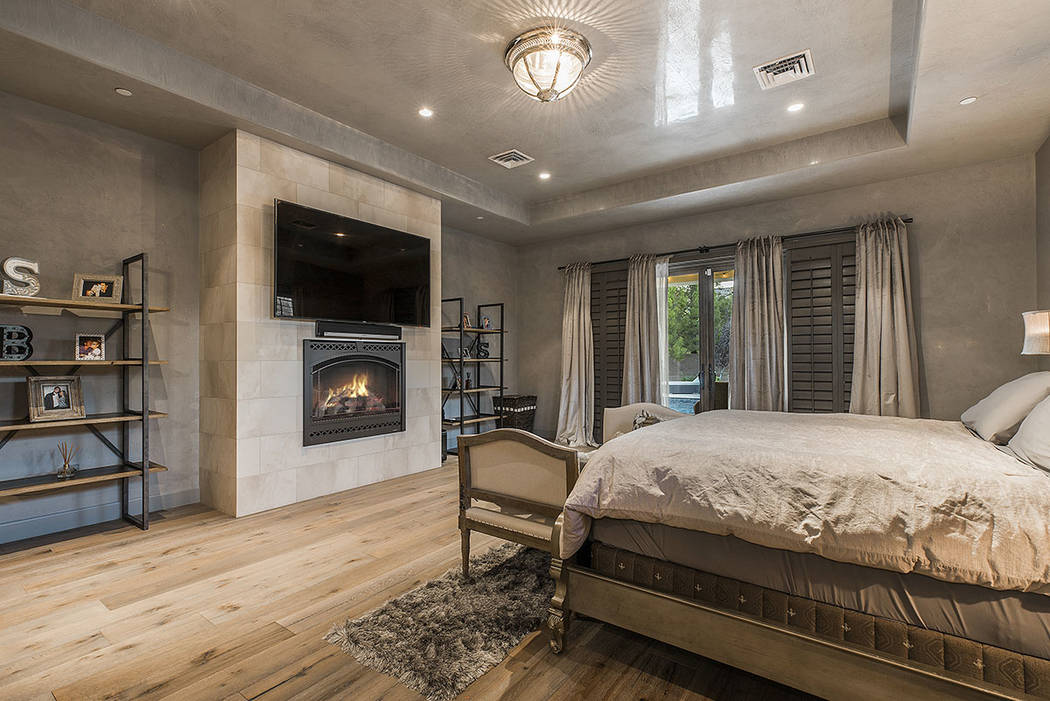 The master bedroom features a fireplace. (Ivan Sher Group)