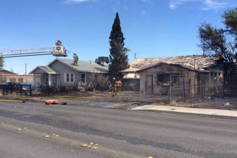 Crews respond to a house fire in the 2100 block of East Stewart Avenue in Las Vegas, Thursday, ...