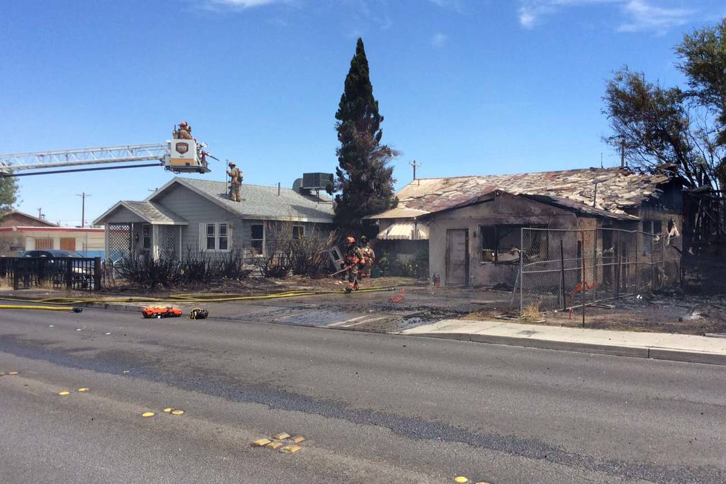 Two houses were damaged in a fire that started in another house in the 2100 block of East Stewa ...
