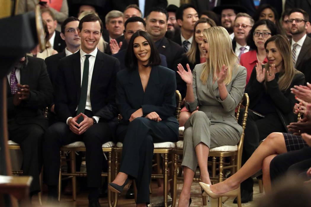 White House senior adviser Jared Kushner and Ivanka Trump, right, sit with Kim Kardashian West, ...