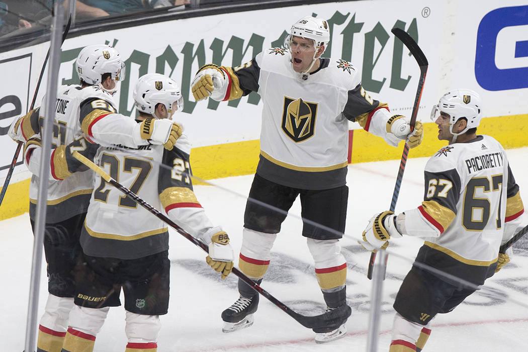 Golden Knights center Paul Stastny (26) celebrates with teammates Max Pacioretty (67) and Shea ...