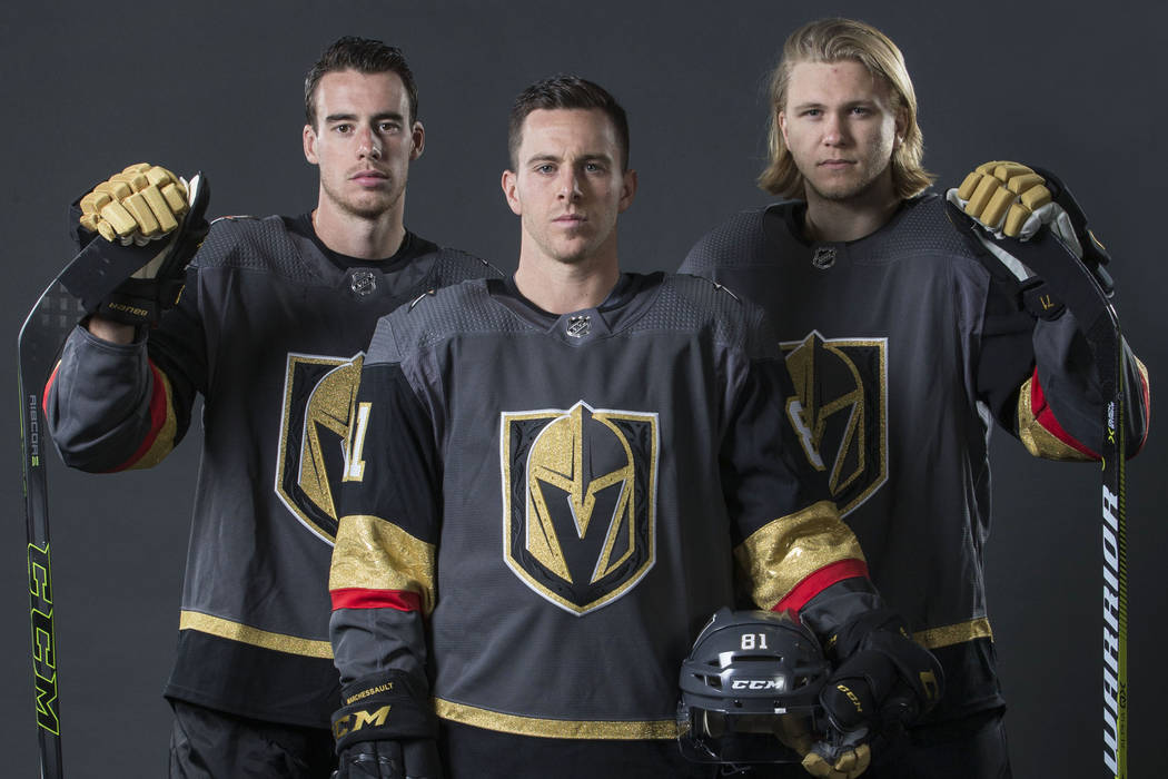 Golden Knights right wing Reilly Smith, left, center Jonathan Marchessault and center William K ...