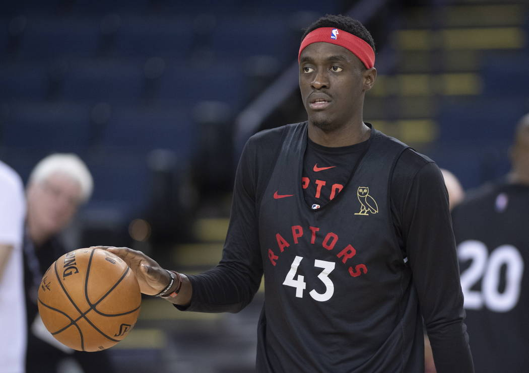 Toronto Raptors' Pascal Siakam dribbles the ball during a team practice in Oakland, Calif., Wed ...