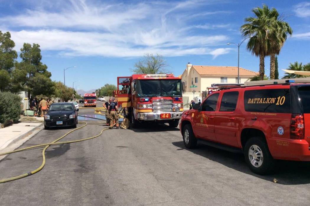 Crews investigate a fire Thursday, June 13, 2019, on the 8300 block of Carmen Boulevard in Las ...