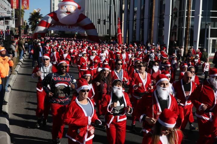 People run in the 14th annual Las Vegas Great Santa Run in downtown Las Vegas, Saturday, Dec. 1 ...