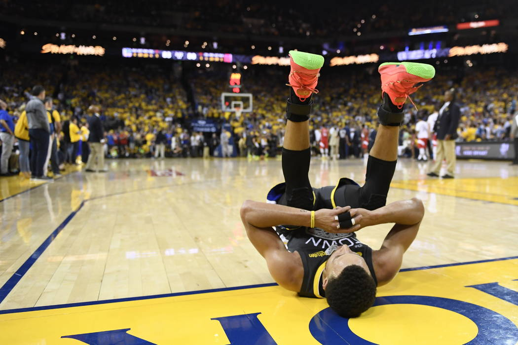 Golden State Warriors guard Stephen Curry reacts after teammate Klay Thompson was injured durin ...