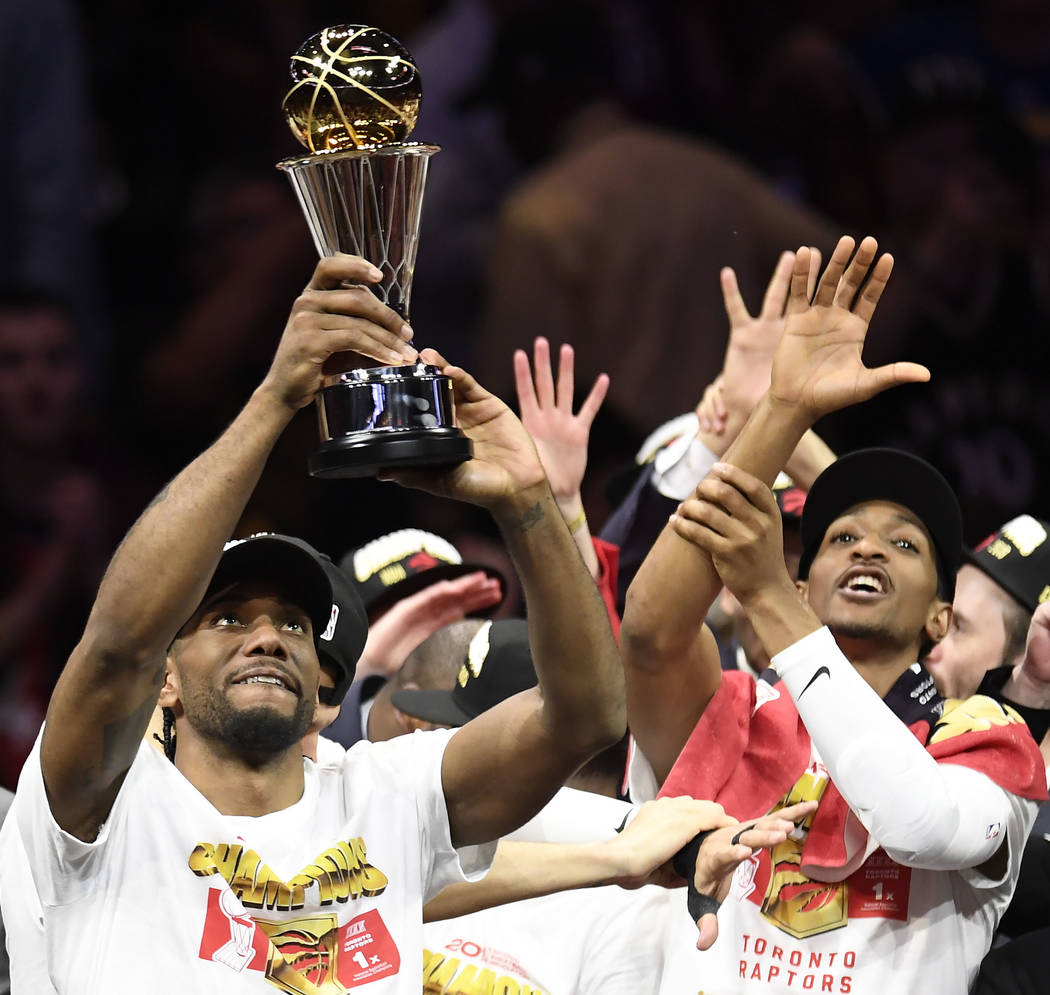 Toronto Raptors forward Kawhi Leonard holds the NBA Finals MVP trophy after the Raptors defeate ...