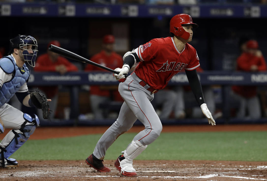 Los Angeles Angels' Shohei Ohtani, of Japan, watches his triple off Tampa Bay Rays' Ryan Yarbro ...