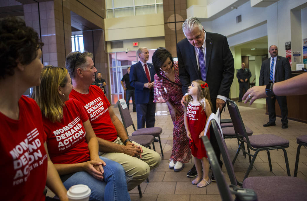 First lady Kathy Sisolak, center, and Gov. Steve Sisolak, talk with Shayna Hendricks, 4, at the ...