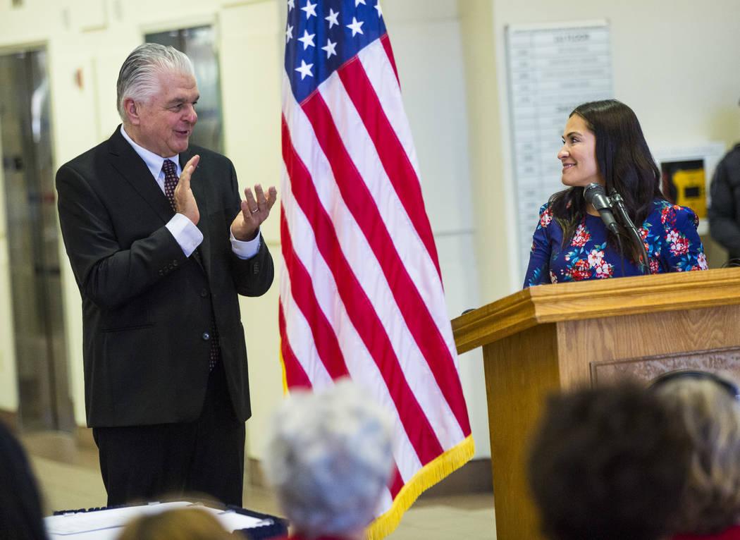 Gov. Steve Sisolak, left, claps as Assemblywoman Sandra Jauregui, D-Las Vegas, speaks before Si ...