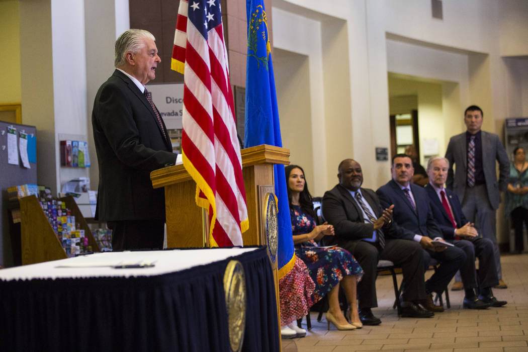 Gov. Steve Sisolak speaks before signing a trio of bills, including AB291, which includes a var ...