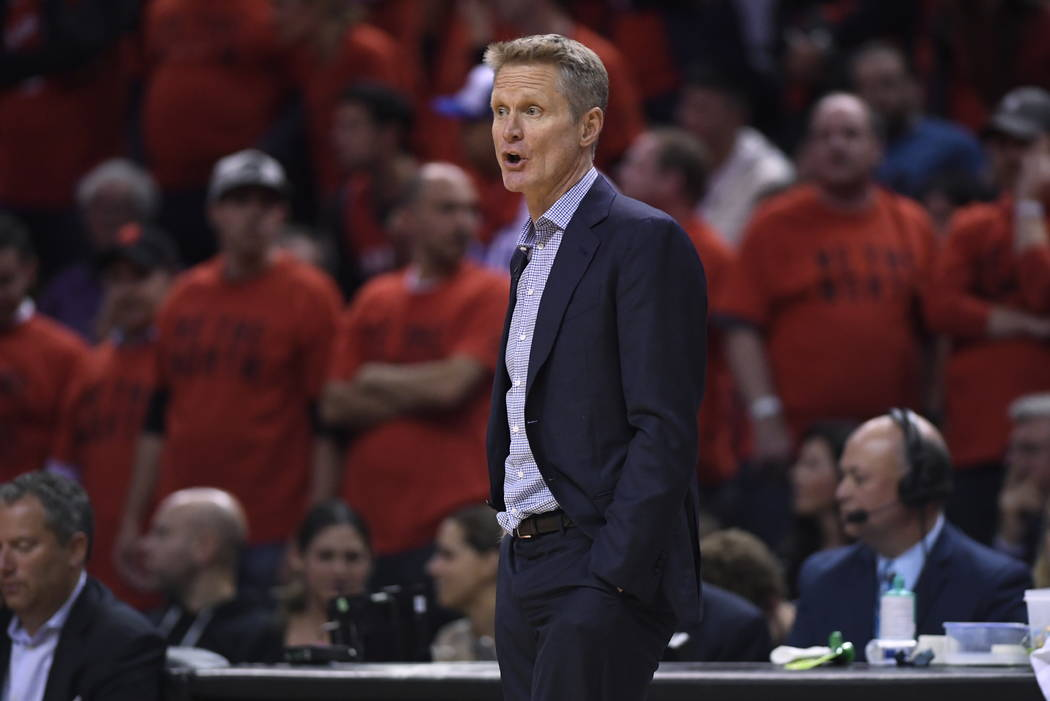 Golden State Warriors coach Steve Kerr watches the action against the Toronto Raptors during se ...