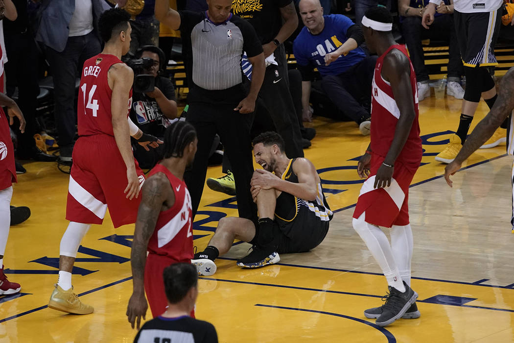 Golden State Warriors guard Klay Thompson reacts after being injured during the second half of ...