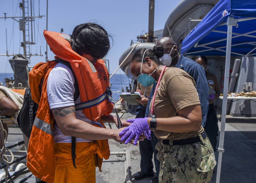 In this June 13, 2019, photo released by the U.S. Navy, sailors aboard the Arleigh Burke-class ...