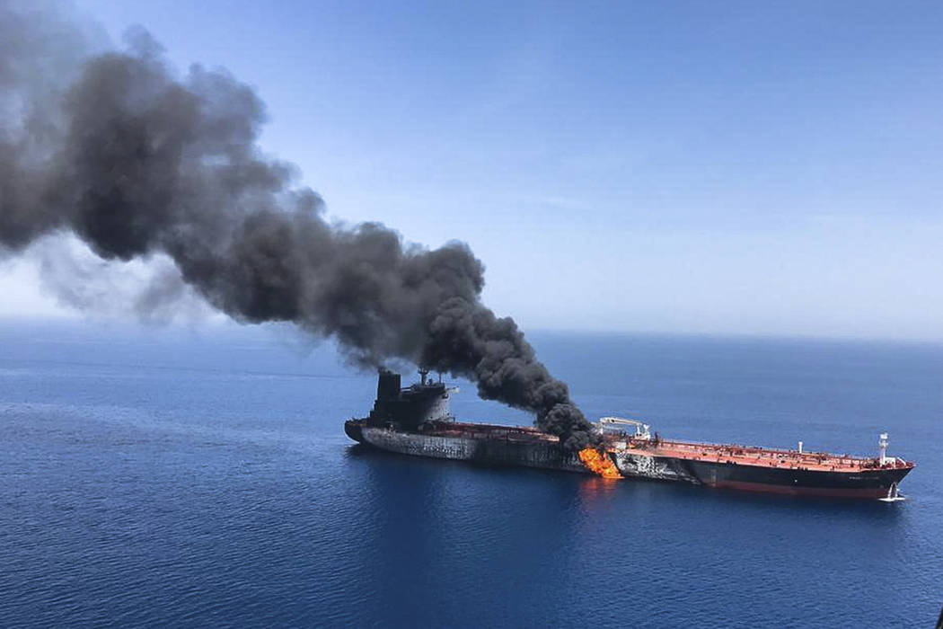 An oil tanker is on fire in the sea of Oman, Thursday, June 13, 2019. Two oil tankers near the ...