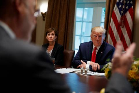 Iowa Gov. Kim Reynolds and President Donald Trump listen as Pennsylvania Gov. Tom Wolf speaks d ...