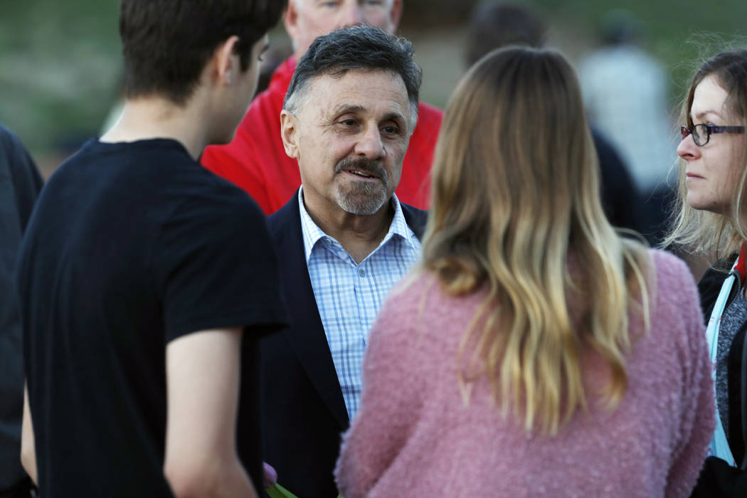 FILE - In this Friday, April 19, 2019, file photograph, Frank DeAngelis, center, greets well-wi ...