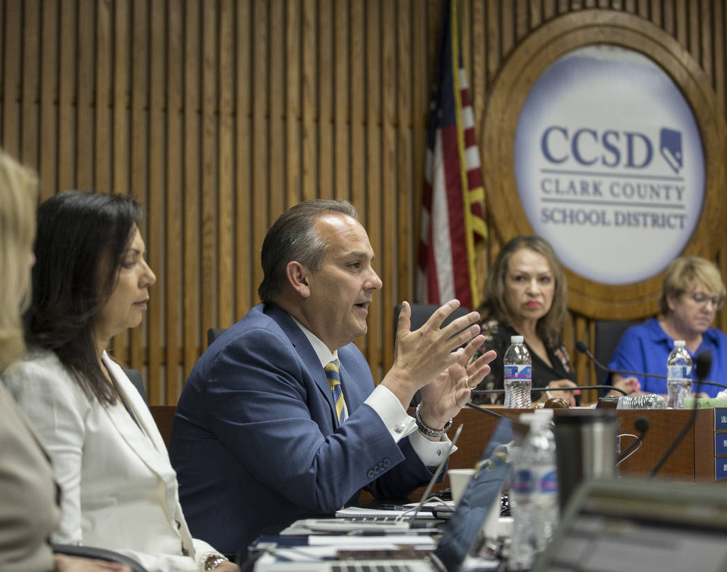 Clark County School Superintendent Dr. Jesus Jara, third from left, addresses the Clark County ...
