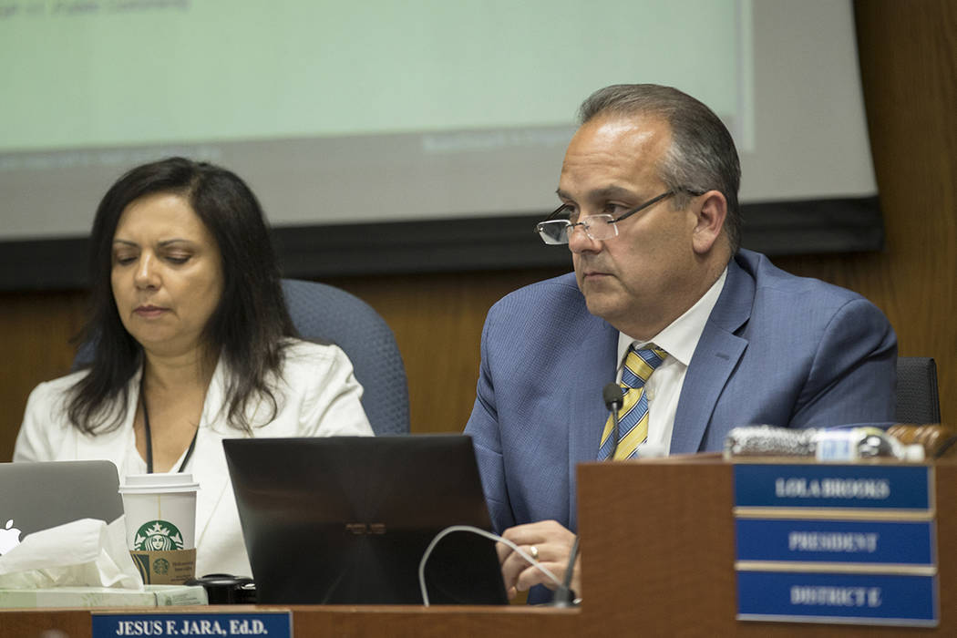 Clark County School Superintendent Dr. Jesus Jara, right, listens to public comments during a m ...