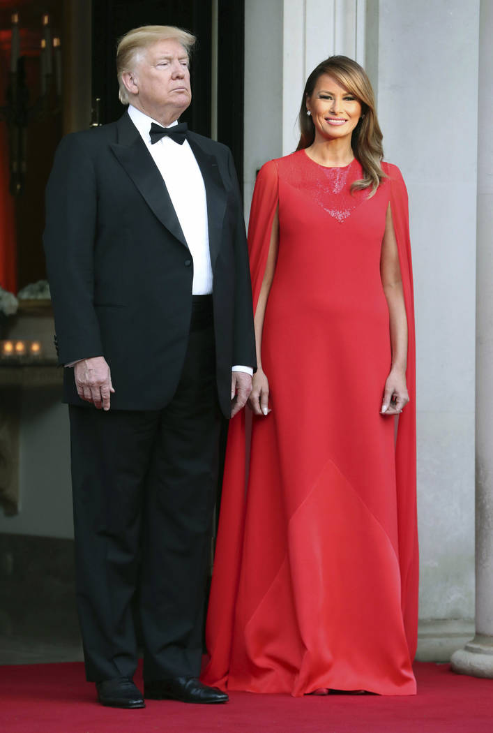 US President Donald Trump and first lady Melania Trump wait to greet Britain's Prince Charles a ...