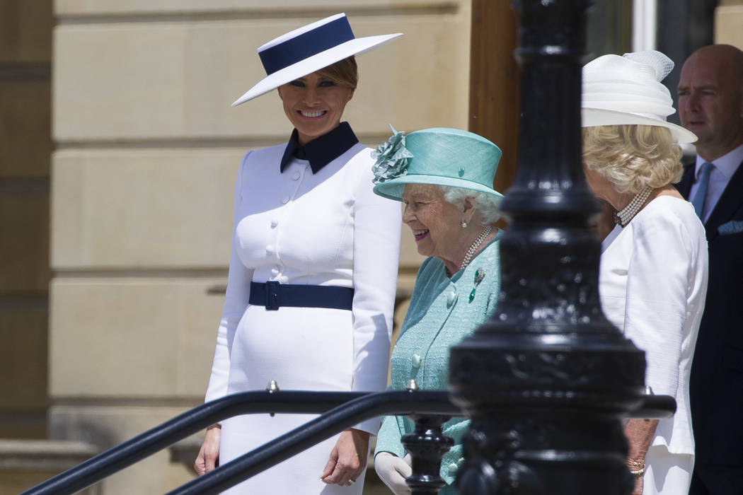 First lady Melania Trump, left, stands with Queen Elizabeth II, and Camilla, Duchess of Cornwal ...