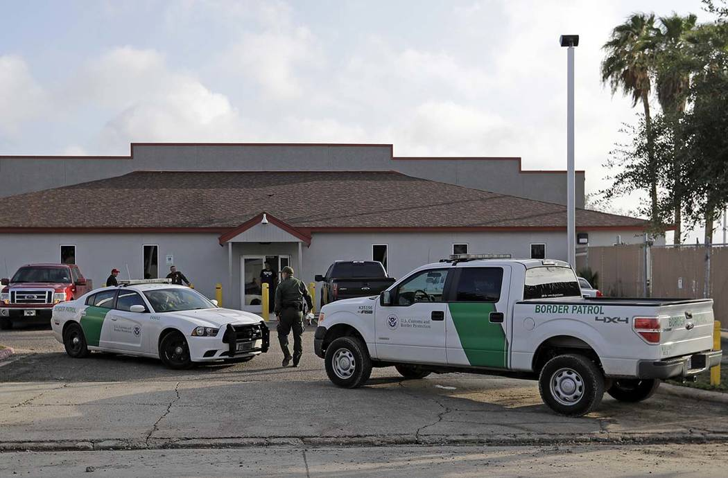 In a Saturday, June 23, 2018, file photo, a U.S. Border Patrol Agent walks between vehicles out ...