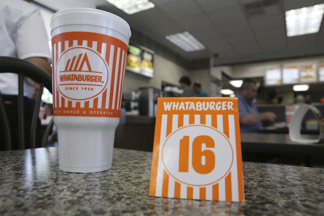 A Whataburger tent order number sits on a table in Dallas, Wednesday, Aug. 9, 2017. (AP Photo/L ...